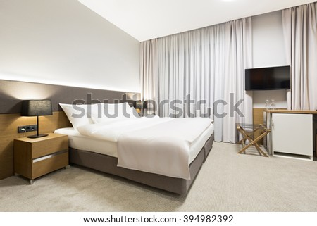 Luxury hotel bedroom in the evening