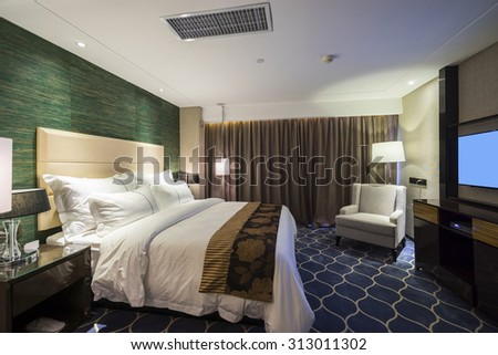 luxury hotel bedroom with nice decoration - stock photo