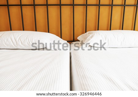 Luxury hotel beds, detail of a clean beds, relaxation and accommodation, hotel
