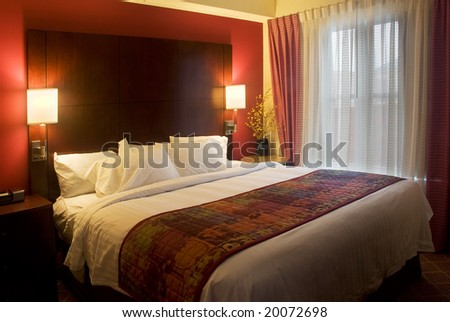 luxury hotel room at dust with lamps on - stock photo