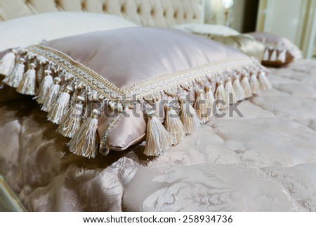 Luxury hotel room setting with bed and a pillows. - stock photo