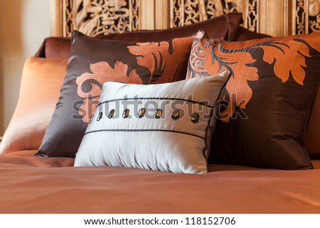 Luxury hotel room setting with bed and pillows. - stock photo