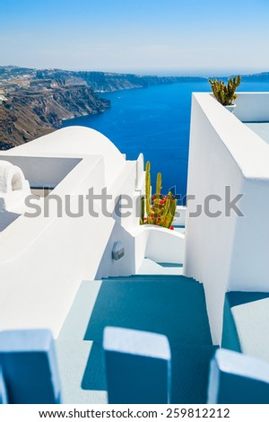Luxury hotel with sea view. White architecture on Santorini island, Greece. Beautiful summer landscape