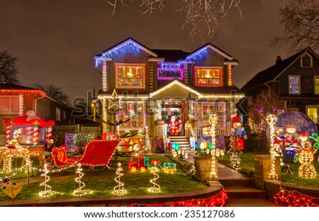 Luxury house decorated and lighted for Christmas and for New Year Eve. Night in Vancouver, Canada. - stock photo