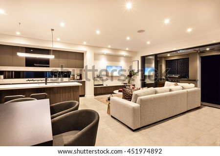 Luxury House Interior With Living Room And The Kitchen With Tables, Chairs,  Sofas With