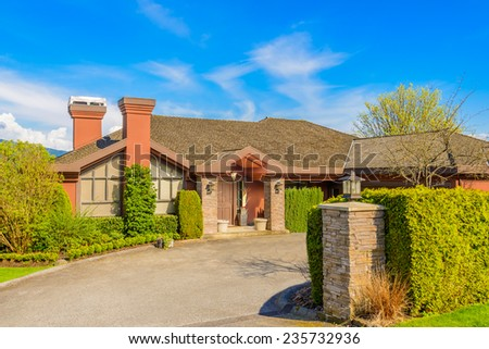 Luxury house with a garage on a sunny day in Vancouver, Canada - stock photo