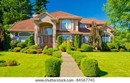 Luxury house with gorgeous outdoor landscape on sunny summer day in Vancouver, Canada. - stock photo
