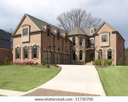 Luxury House with long driveway green grass - stock photo