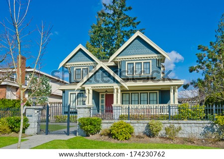 Luxury house with nicely trimmed and landscaped front yard lawn in the suburbs of Vancouver, Canada. - stock photo