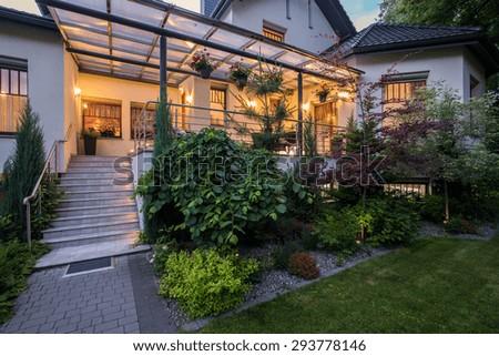 Luxury house with verandah and beauty garden - stock photo