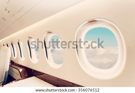 Luxury interior in bright colors of genuine leather in the business jet - stock photo