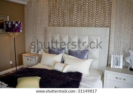 luxury interior of bedroom with large bed