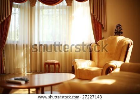 Luxury interior with leather armchair. Shallow DOF, focus on armrest. - stock photo