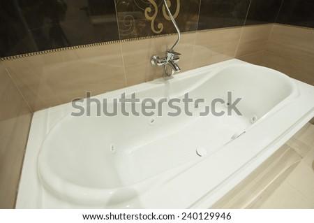 Luxury jacuzzi bath tub in bathroom of apartment - stock photo