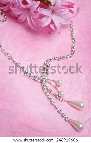 Luxury jewellery pearl over pink background - stock photo