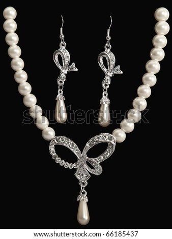 luxury jewellery pearl set (necklace and earrings) over black background - stock photo