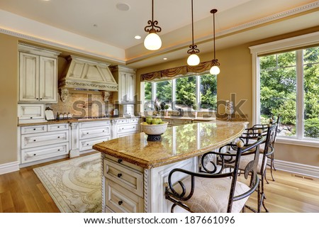 Luxury kitchen room with island and chairs. - stock photo