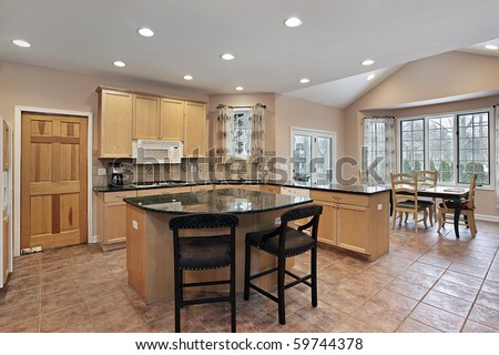 Luxury kitchen with eating area and center island - stock photo