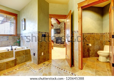Luxury large master bathroom in mountain home with double sink and green walls.