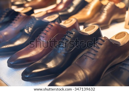 luxury leather male shoes in the shop - stock photo