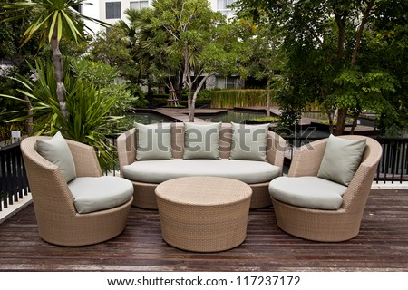 luxury lifestyle sofa and green pillows in the garden
