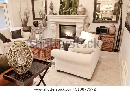 Luxury living room with a lot of decorations and a marble floor. Interior design. - stock photo