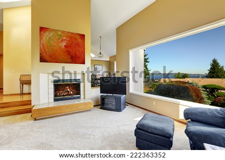 Luxury living room with high vaulted ceiling and large window with scenic bay view - stock photo