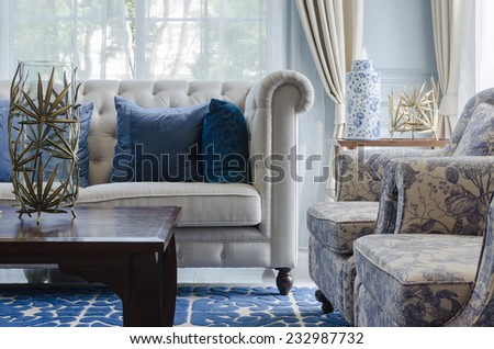 luxury living room with sofa on blue pattern carpet - stock photo