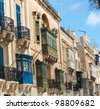 luxury mansions baroque style with the traditional balconies wooden in a Valletta street, Malta - stock photo