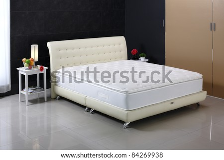 Luxury mattress and bedding set in an interior bedroom - stock photo