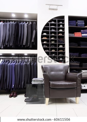 Luxury men's clothes and accessories in modern shop - stock photo