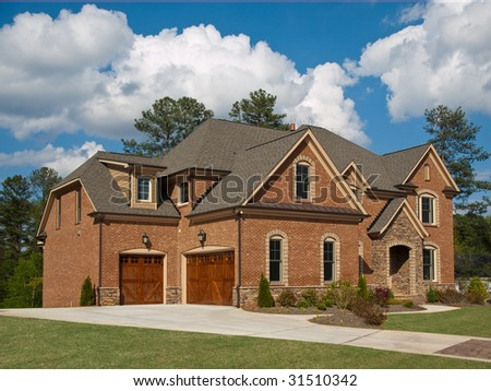 Luxury Model Home Exterior with cloudy sky - stock photo