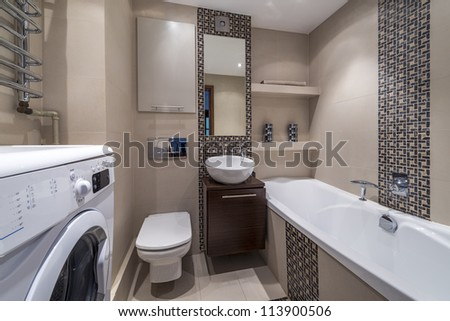 Luxury modern bathroom suite with bath and washing machine - stock photo