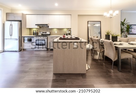 Luxury modern kitchen with dining room, table. Interior design of a brand new house.