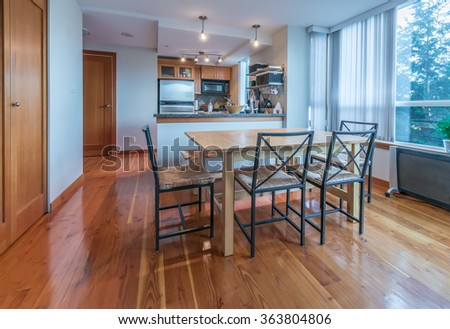 Luxury modern living suite: dining table and the kitchen at the back. Interior design. - stock photo