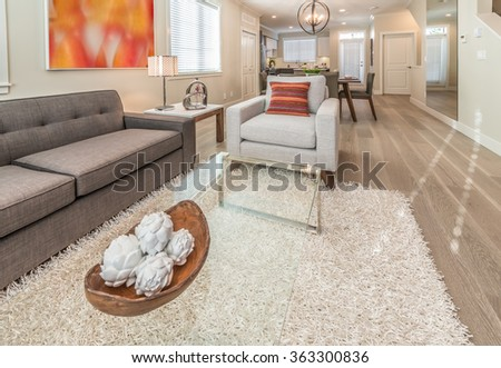 Luxury modern living suite : living room with modern chair and dining suite and the kitchen at the back.  Interior design. - stock photo