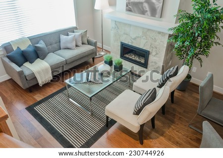 Luxury modern living suite, room with sofa and chairs and nicely decorated with vase coffee table. View from above. Interior design of a brand new house. - stock photo