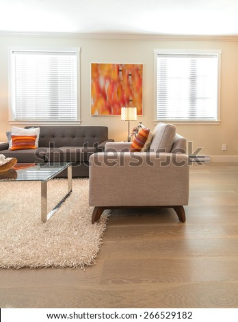Luxury modern living suite.  Room with sofa and chairs and nicely decorated with vase coffee table. Interior design of a brand new house. Vertical. - stock photo