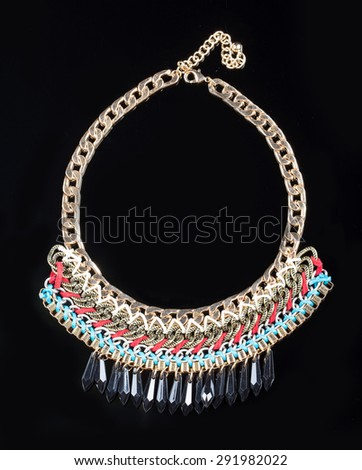 luxury necklace on black stand - stock photo