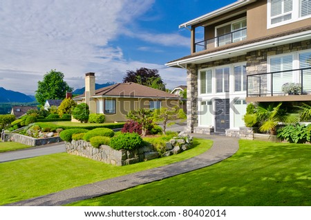 Luxury neighborhood with shadows of big trees in Vancouver, Canada. - stock photo