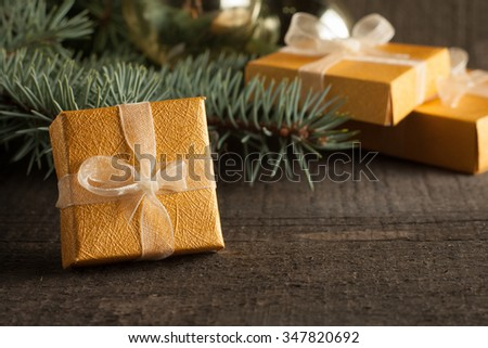 Luxury New Year gifts, different present boxes under Christmas tree in holiday eve, Christmastime celebration, home decorated with festive shiny balls, magic night - stock photo