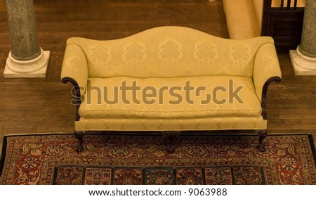 Luxury old couch in hall - stock photo