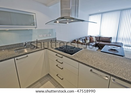 luxury open plan kitchen with modern electric appliances - stock photo