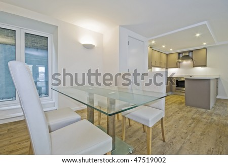 luxury open plan living room with dining table - stock photo
