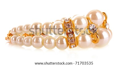 Luxury pearl bracelet on whie background - stock photo