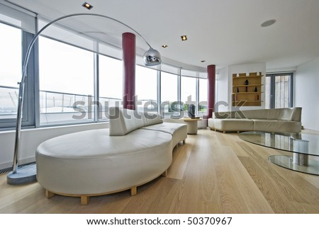 luxury penthouse living room with massive leather sofas - stock photo