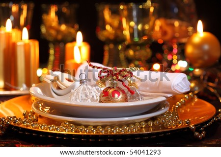 Luxury place setting in golden and white  for Christmas - stock photo