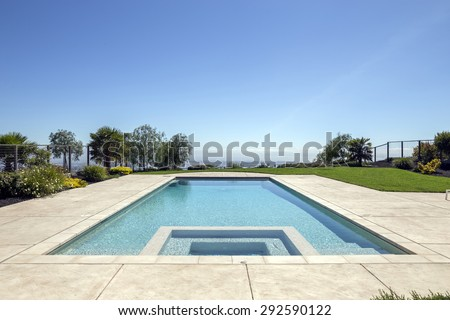 Luxury Pool in blue with Jacuzzi / Whirlpool. - stock photo
