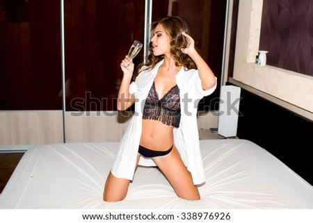 luxury portrait of woman celebrate her home party,and drinking alcohol,sparkle champagne and white vine,cool style,outdoor portrait of sensual woman,wear luxury  suit portrait  - stock photo