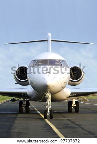 Luxury Private Jet Plane -  Front view - Bombardier Global Express - stock photo